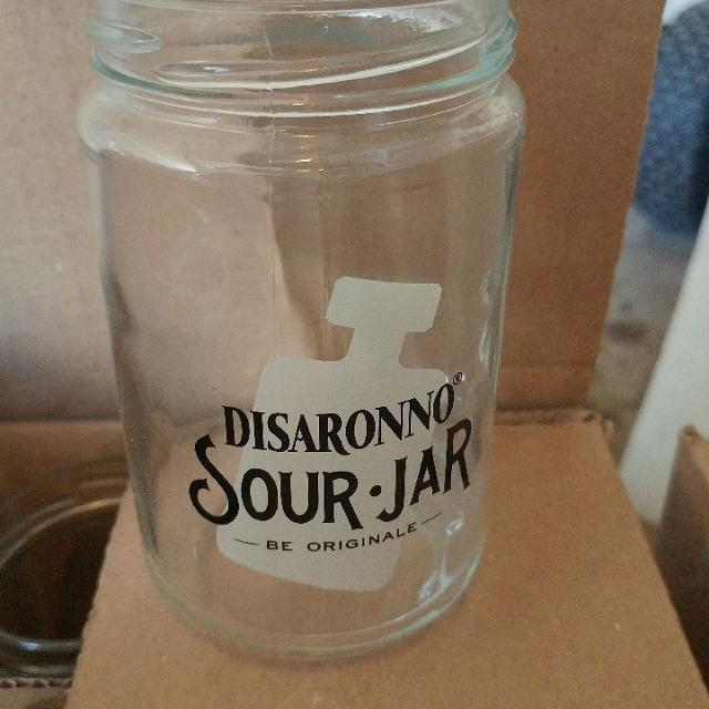 4 cases of brand new disaronno sour jars