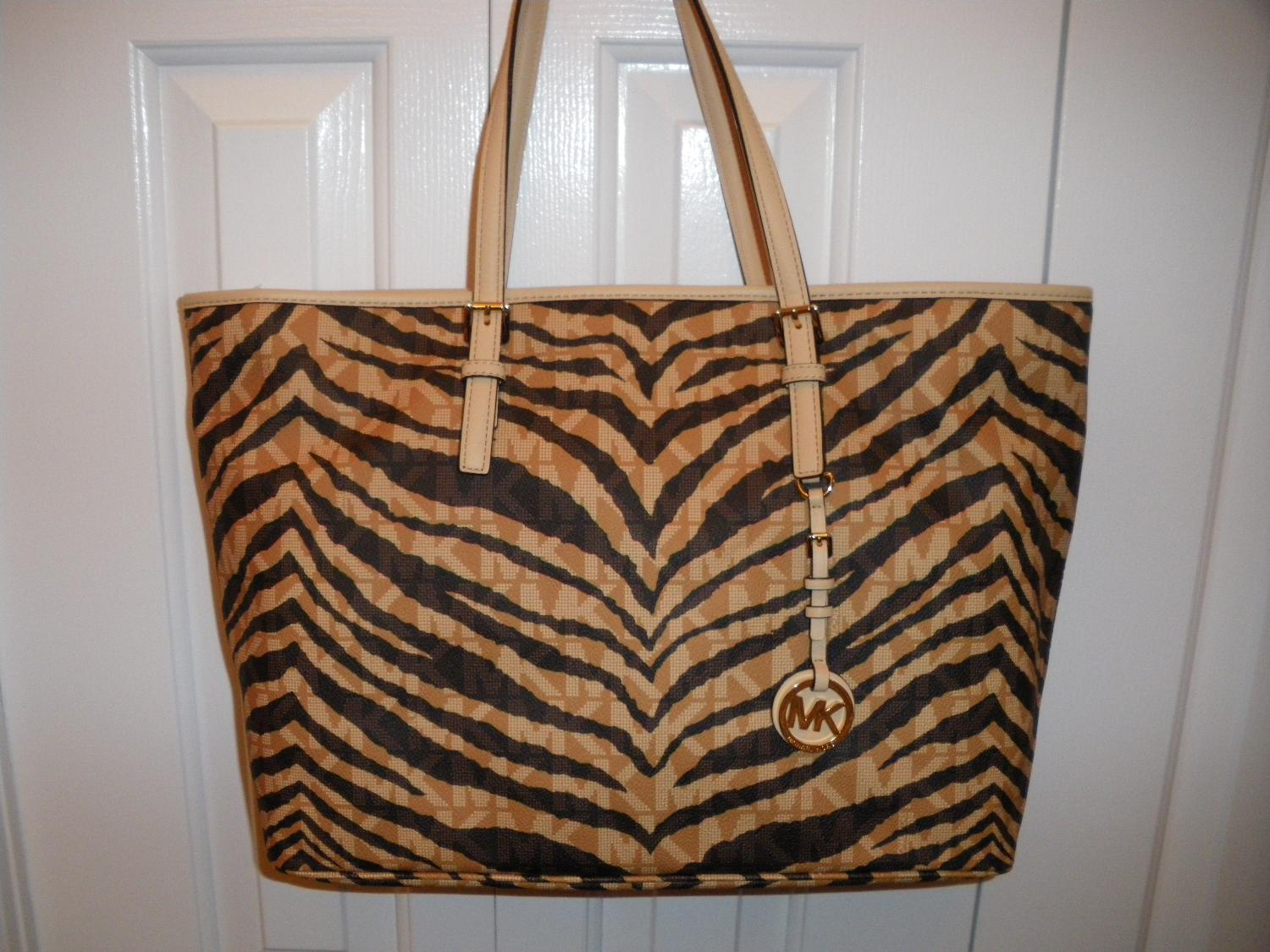 515c8150e93d55 Find more Bnwt Michael Kors Jet Set Brown Tiger Tote for sale at up ...