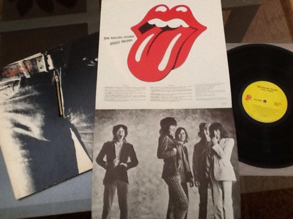 Rare Rolling Stones Sticky Fingers (working zipper) record in excellent  condition with original poster  $20