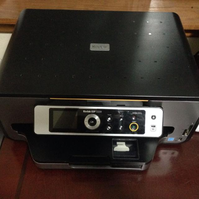 Kodak ESP 7250 photo printer  Manual, setup directions, cord, CD software  included  3 yrs old barely used  Asking $275 00