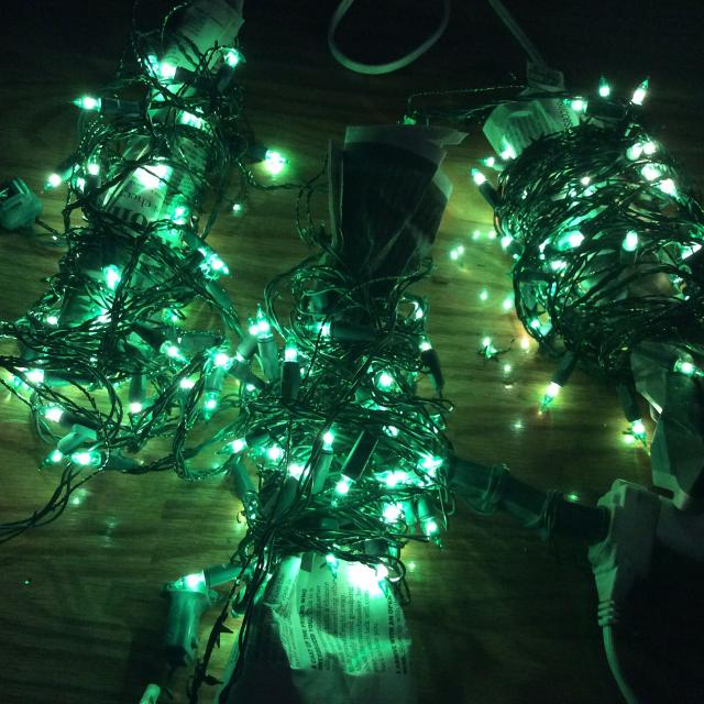 3 strands of green christmas lights with green star wire for extra sparkle wrapped around each