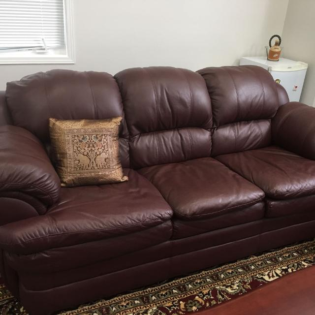 4 pc Leather sofa set, 3 pc coffee table set, 2 display units and Area rug