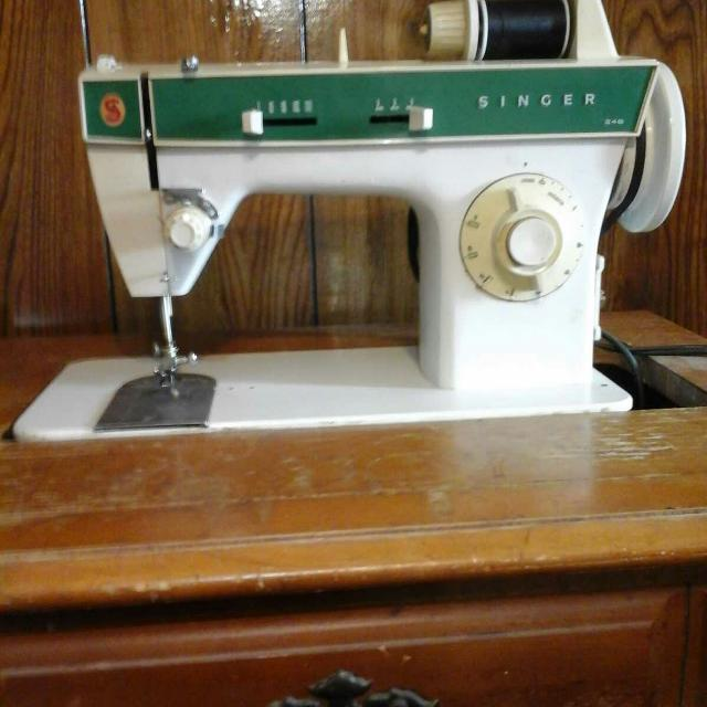 Electric Singer sewing machine and table, model 248