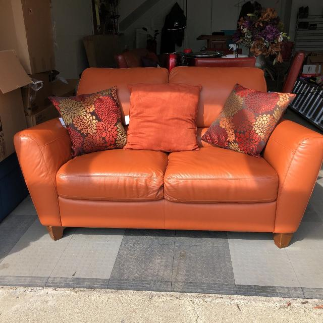 Rustic Orange Italian leather couch and loveseat combo