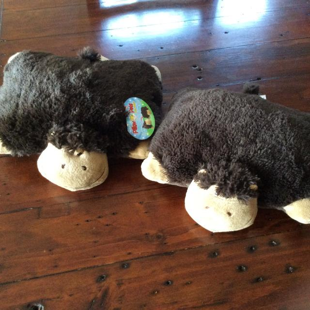 2 EUC monkey pillow pets, 1 is brand new with tags, smoke and pet free  home, pick up in steveston