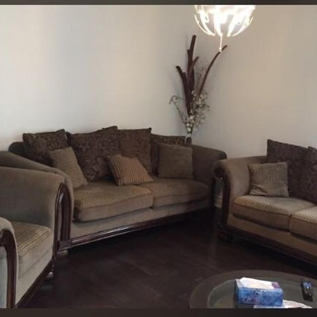 Brown fabric sofa set with throw pillows