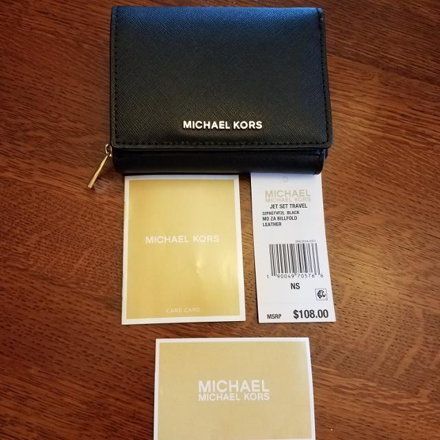 b6cce11c14c9 Best Price Reduced! New With Tags- Michael Kors Wallet for sale in ...
