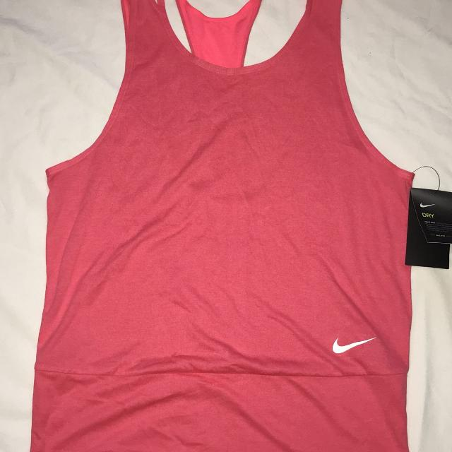 Find more New Nwt Women s Nike Slouchy Pink Tank Top Sz. M for sale ... 4b3cce3faf