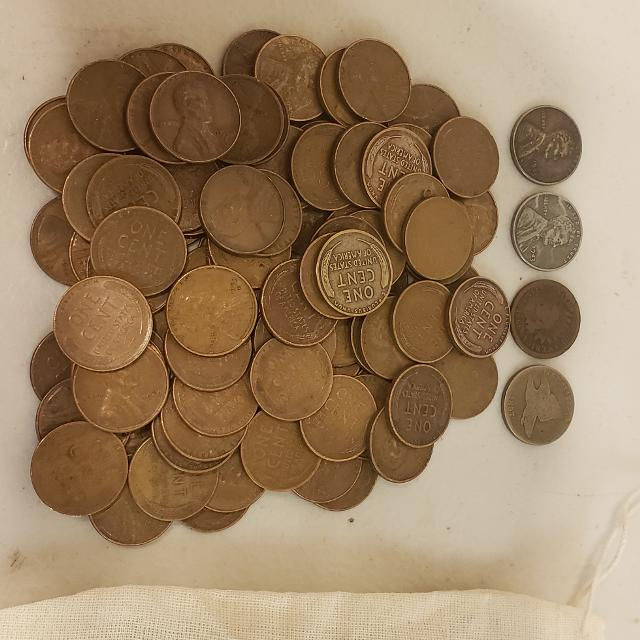 100 wheat pennies with an 1866 and 1857 pennies