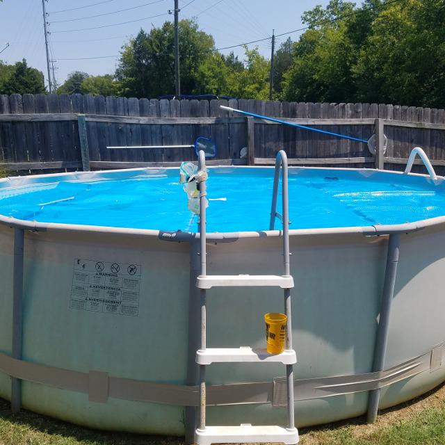 POOL SUPPLIES!!! 14 ft. Pool Solar Cover, skimmer, filters, chlorine  tablets and ladder