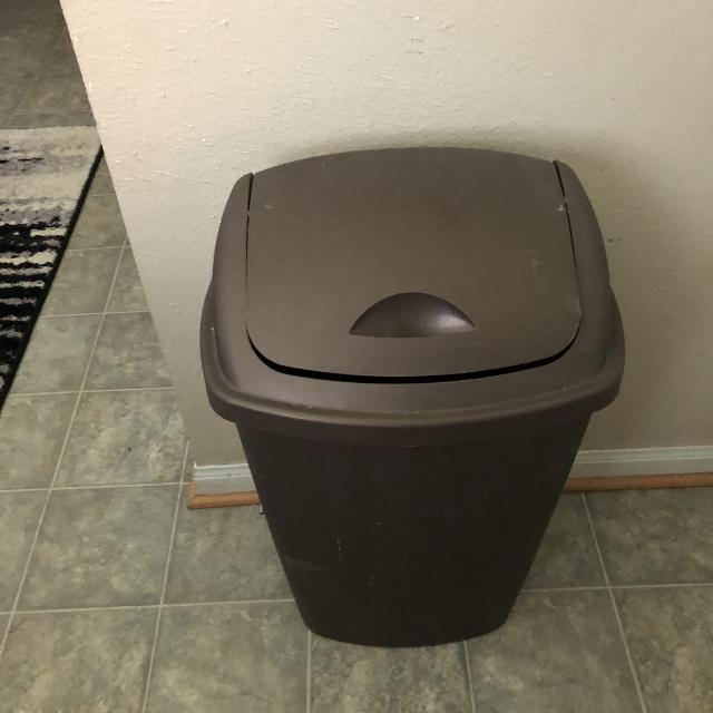Used brown kitchen trash can.