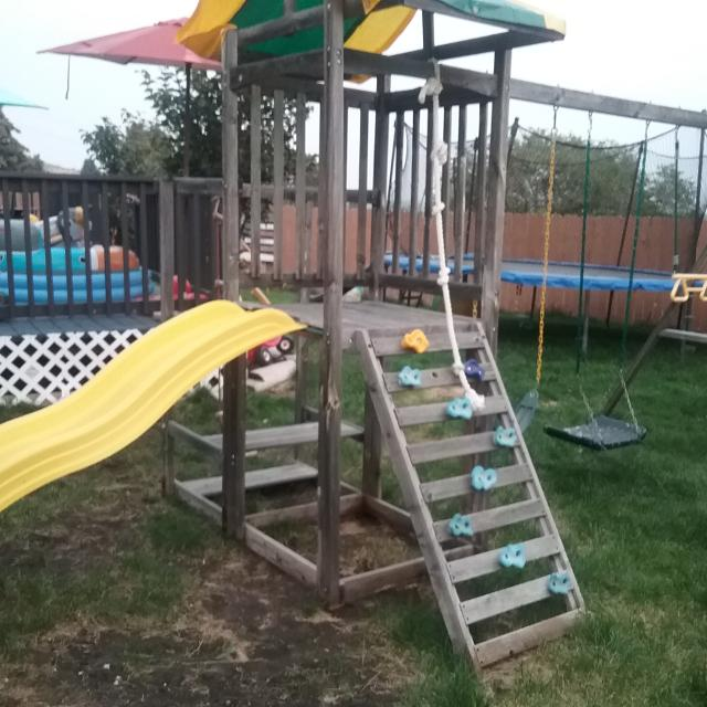 Kids Outdoor Swing Set Has Small Picnic Bench Swings Trapeze Canopy And Climbing Rope