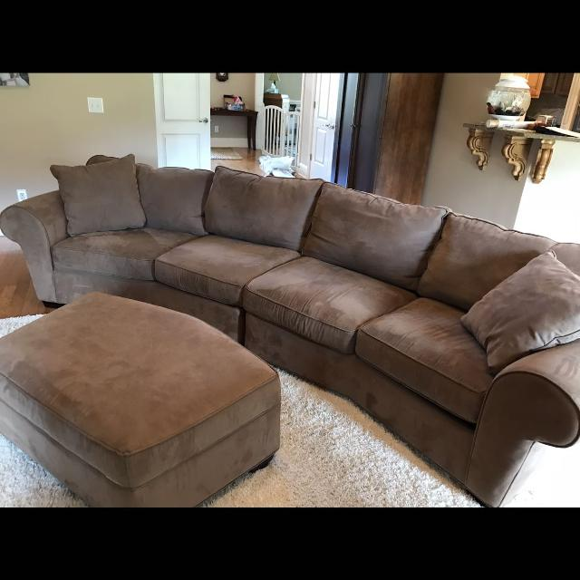 Large microfiber curved sofa (comes apart in the middle) with 2 storage  ottomans (only 1 pictured above)