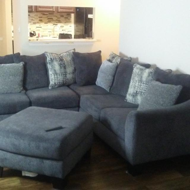 Grey sectional sofa with ottoman