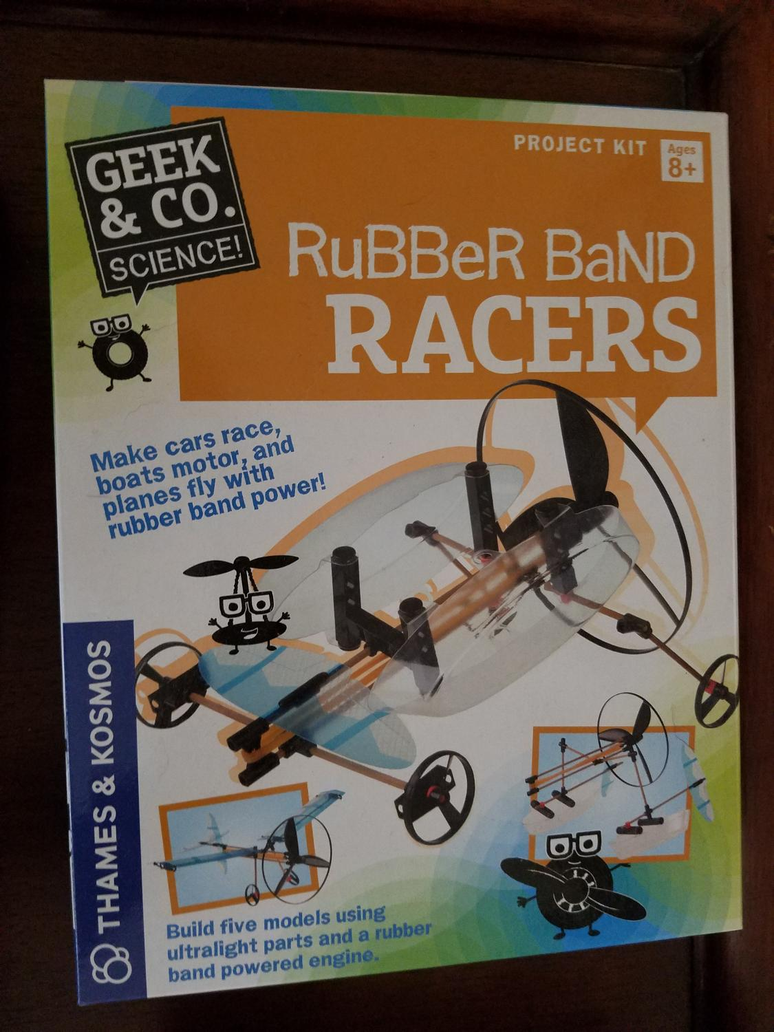 New In Box Rubber Band Racers
