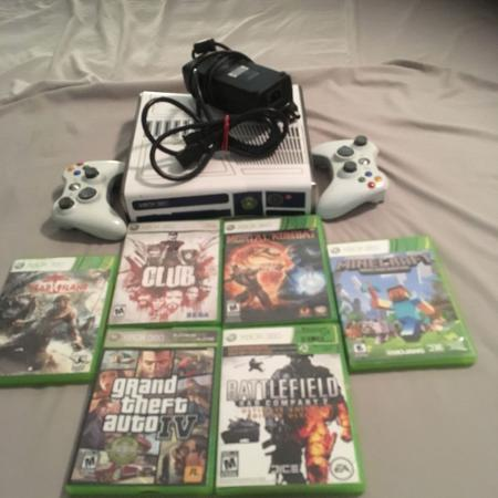 Xbox 360 with remotes 6 games and the... for sale  Canada