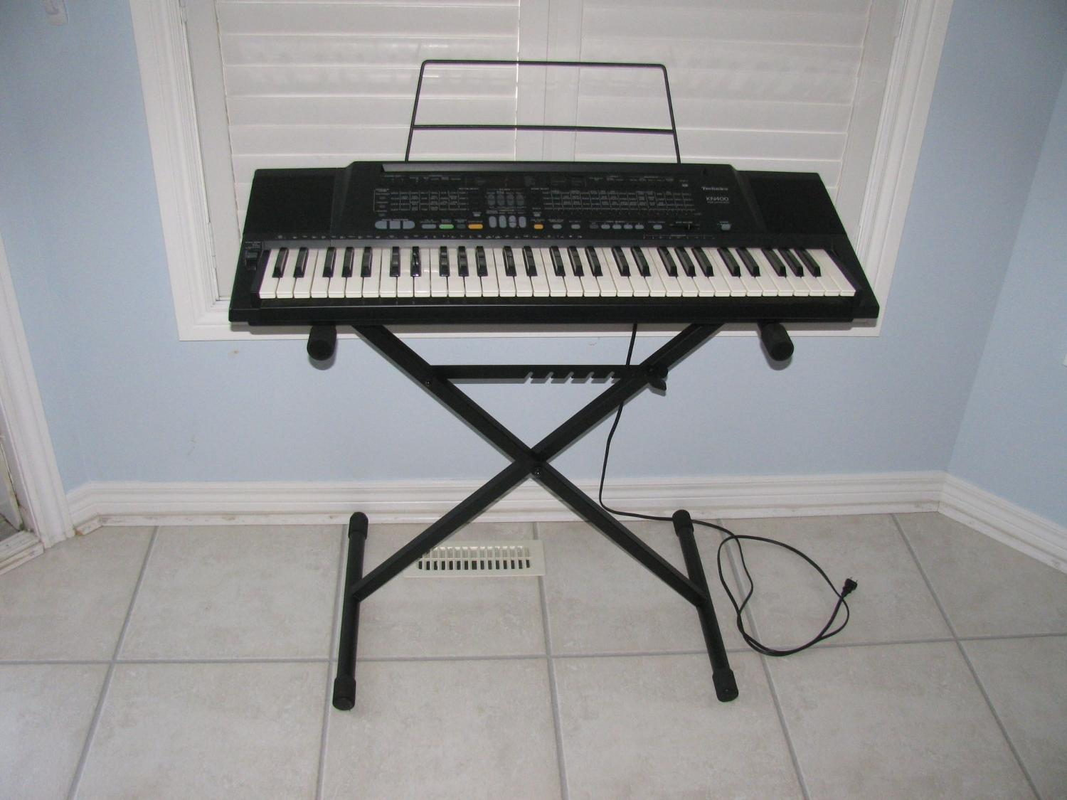 Multi-Feature Technics KN400 Keyboard, Stand and User Manuals