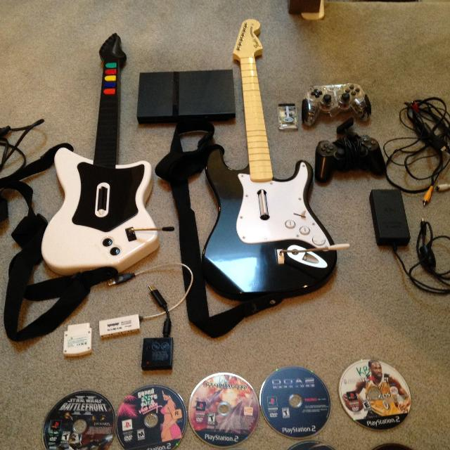 PS2 PACKAGE !! Console 21 Games 2 Controllers Guitar Hero & Rock Band -  $120 OBO