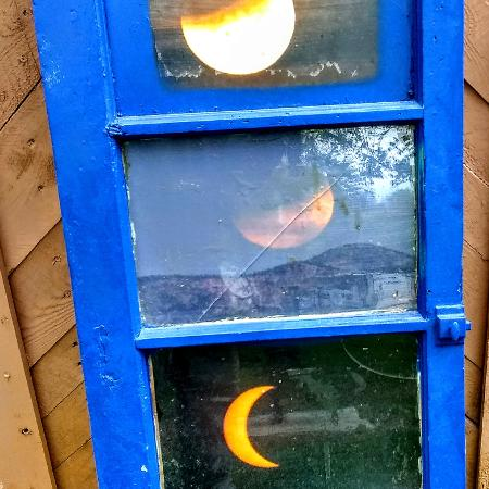 200f8d929 Eclipses framed with old window