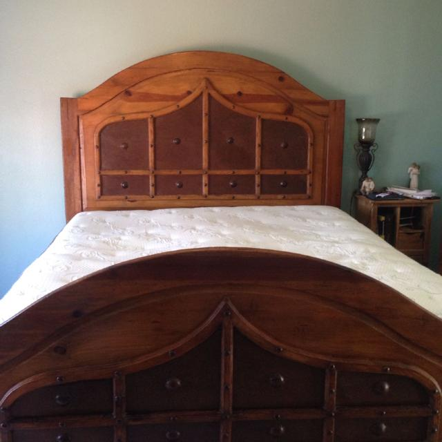 king size wormwood bed frame and two tall wooden nightstands reduced
