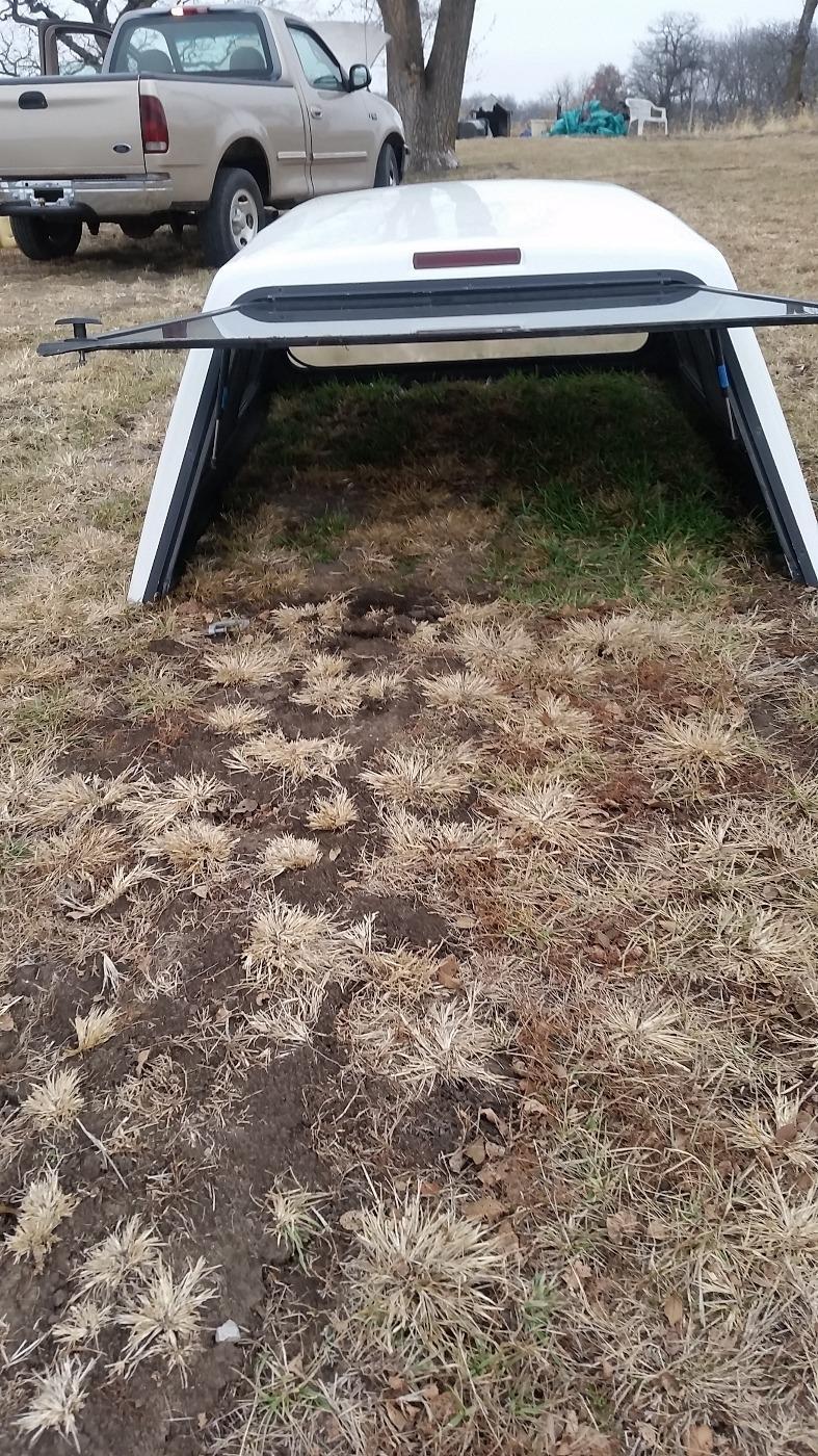 White Fiberglass Raven Camper shell for long bed truck