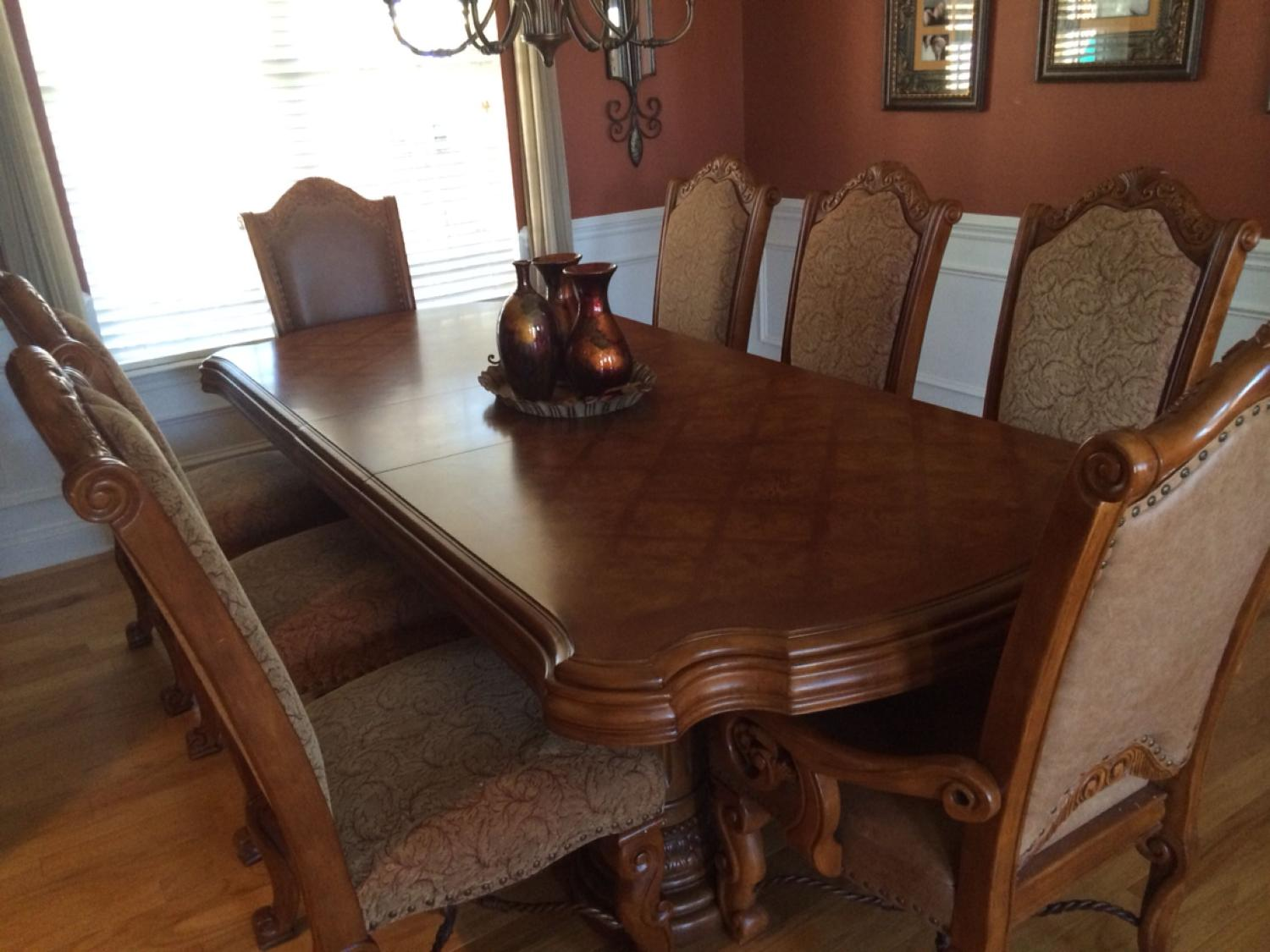 AICO Monte Carlo Dining Room Suite by Michael Amini. We paid well over  $6000 for the dining room table and 10 chairs. $950