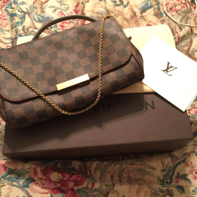 a4e923f864f Best Authentic Louis Vuitton Favorite Mm Clutch In Damier Ebene. for sale  in Mountain Brook, Alabama for 2019
