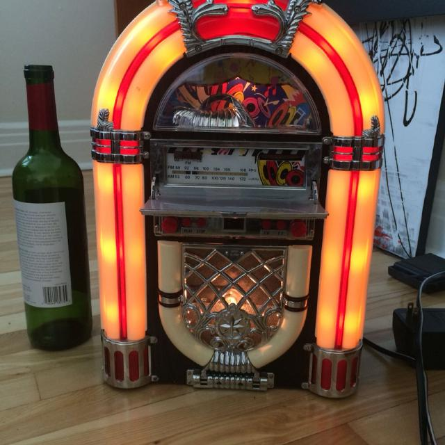 Mini jukebox ( radio and cd player but the door for cd player is not  closing conpletely, still works with a tape inside)