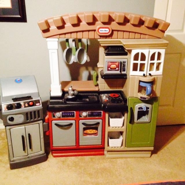 Little tikes play kitchen with grill. Has pans, tongs, spatula, phone, ice  cubes, and coffee pot. Excellent shape.