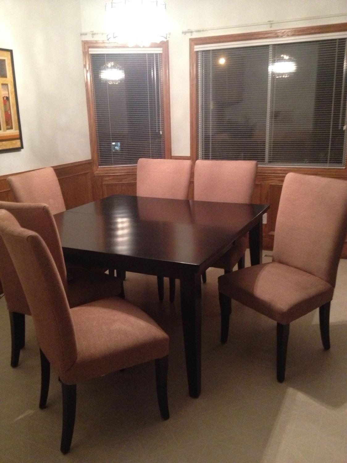 Ashley furniture kitchen table with chairs. Solid wood table. Oversized  chairs make it great for sitting around the tbl. Comes with leaf.