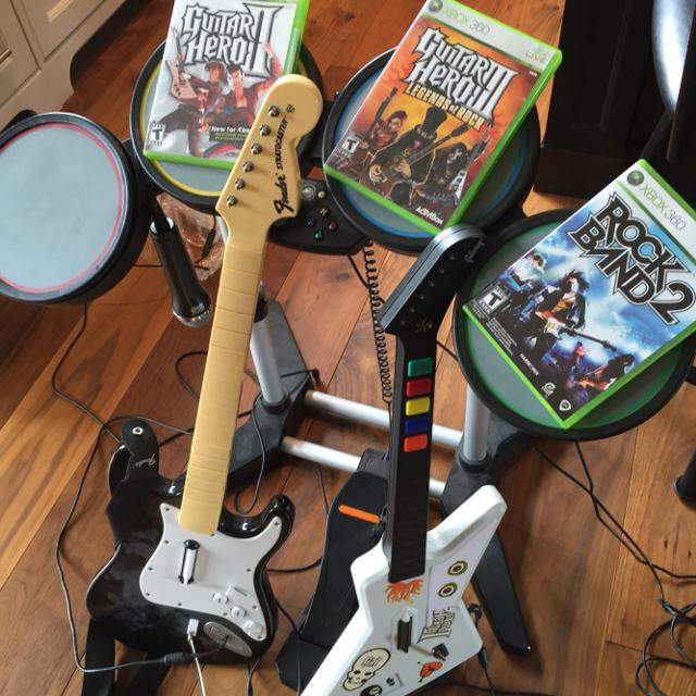 Xbox 360 guitar hero games X2, and Rock Band 2   INCLUDES 2 guitar hero  guitars, 1 microphone, and drum set all for Xbox 360 REDUCED!!