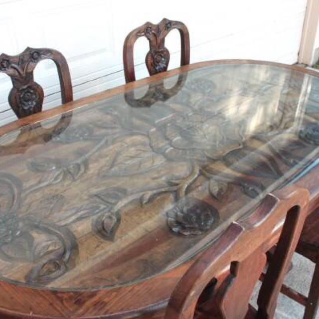 Gorgeous carved all solid wood dining table and 4 chairs  Glass top to  protect it. Find more Gorgeous Carved All Solid Wood Dining Table And 4 Chairs