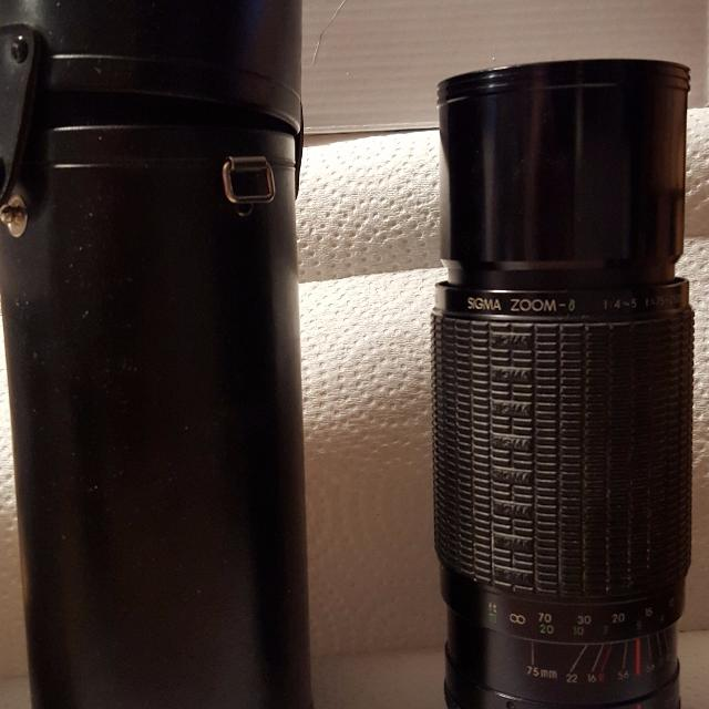 Sigma Zoom-8 75-250mm F/4-5 multi-coated lens with a Kenco Skylight (1A)  52mm Filter for Nikon