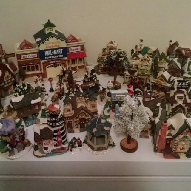 christmas village complete with housespeople trees and a light up walmart