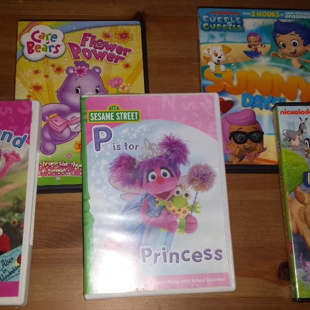 5 Dvds of various kid shows Sesame Street Abby, Care Bears, Umizoomi,  Bubble Guppies