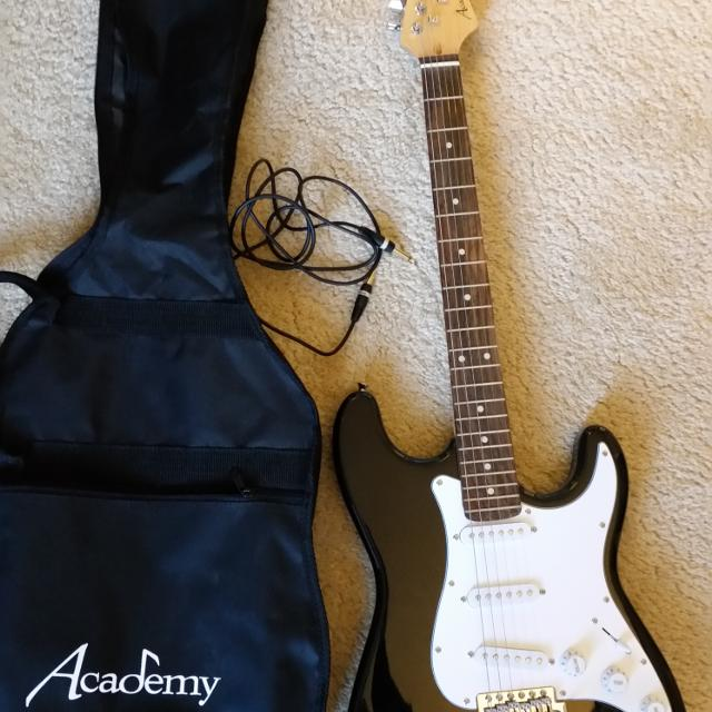 Academy brand electric guitar with case and amp cord  Excellent condition   Smoke free home  No delivery/holds