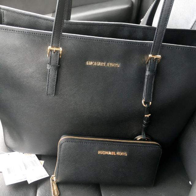 262e500ef29 Best Large Leather Michael Kors Jet Set Travel Tote In Black And Gold With Matching  Wallet. Excellent Condition . Authentic With Tags And All. for sale in ...