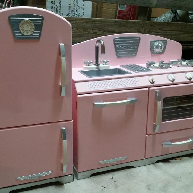 KidKraft 2 Piece Pink Retro Kitchen and Refrigerator. Good used condition.  A little water damage on bottom.