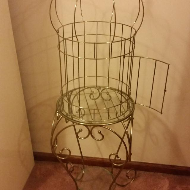 Home interior stand with decorative birdcage