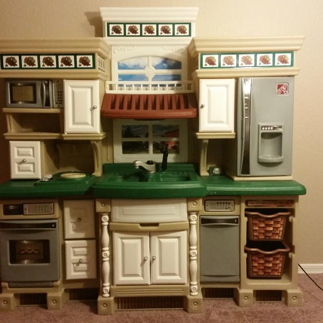 A Compact, Upscale, Colorful Kids Play Kitchen for Little Culinary Artists The Little Bakers Kitchen is compact, upscale and colorful, perfect for your little chef.