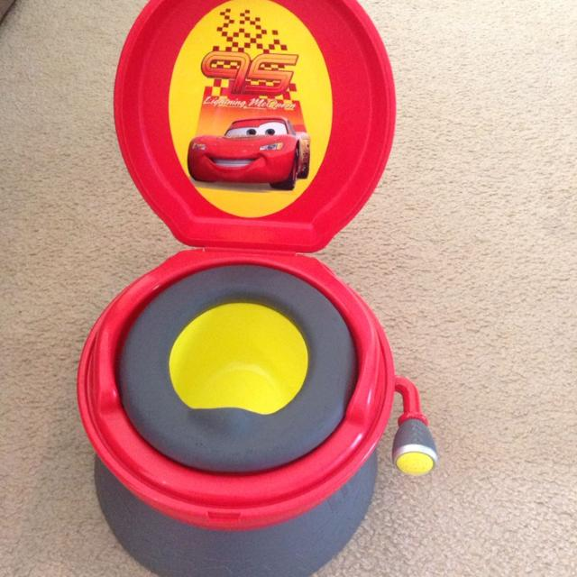 the first years disney pixar cars rev and go potty system reduced