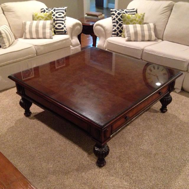 48x48 coffee table solid wood with a custom glass top for protection. It  has 2 - 48x48 Coffee Table IDI Design