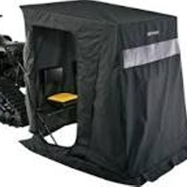 Two Man Ice Shelter  Still in box  Full C style door, windows, flame  resistant fabric, 2 built in seats w/ backrests  Retail $500 00