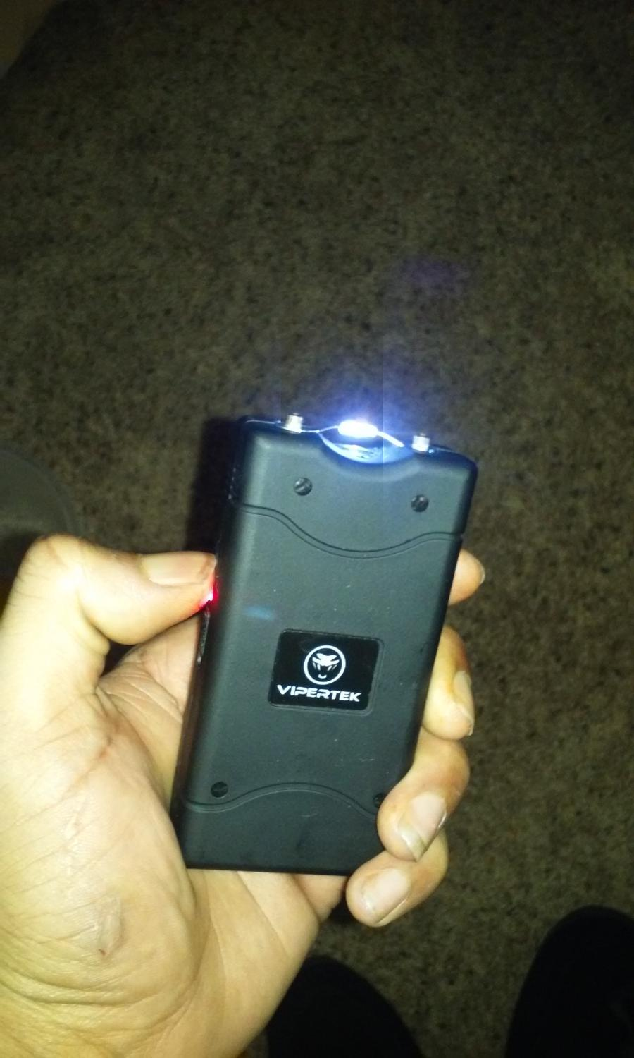 Vipertek taser with flashlight and built in wall charger