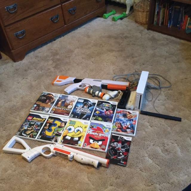 Wii console in excellent condition with two remotes, one nunchuck, two  hunting guns, 11 games  REDUCED