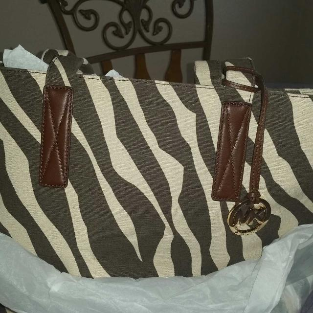 fa284fa38f1377 Find more Authentic Michael Kors Zebra Canvas Tote for sale at up to ...