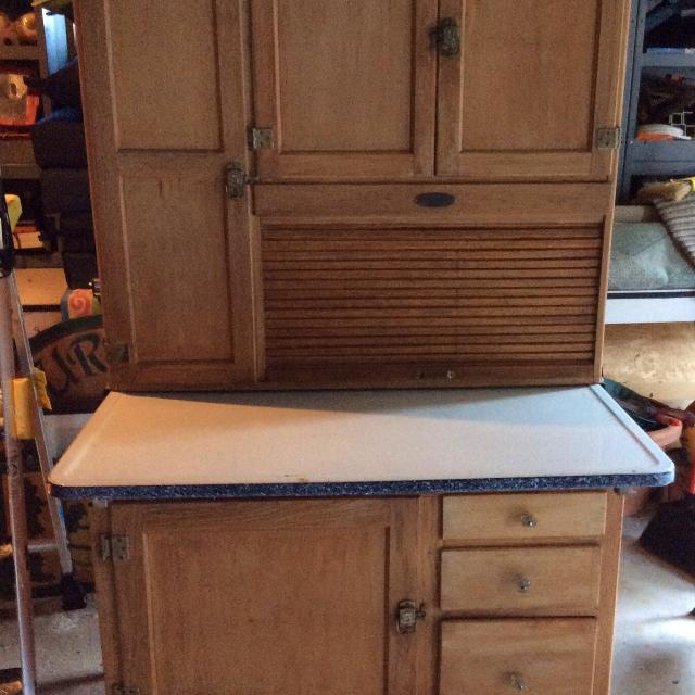 Hoosier Cabinet with roll top desk and granite top.