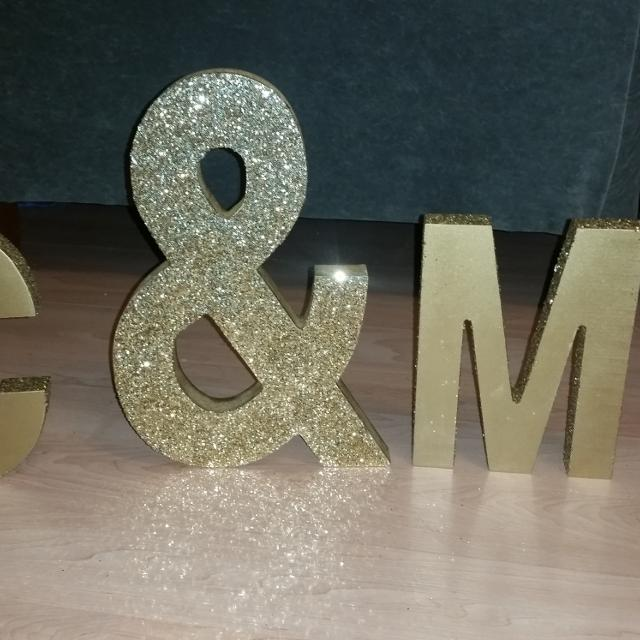 gold and sparkle letters c m