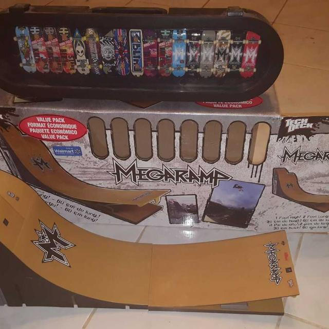 Tech deck mega ramp with 17 boards and wall display case