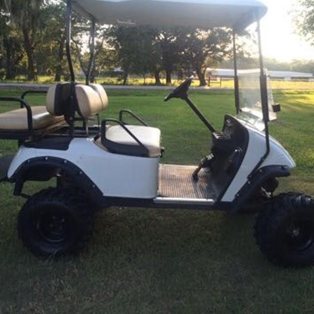 Easy Go Golf Cart With Light Bar And Marine Speakers